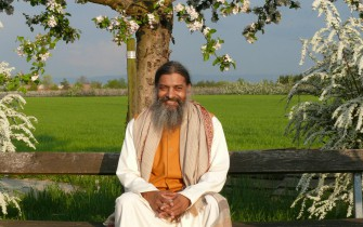 Babaji under Tree blossoms