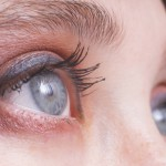 An image of expressive blue woman's eyes