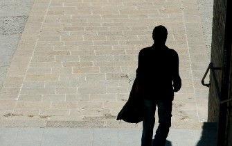 Man with shadow / Dreamstime