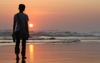 person at sunset_pan