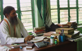 Babaji at his desk