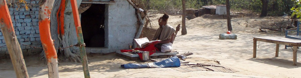 sadhu in front of hut