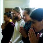Devotees praying to the deities